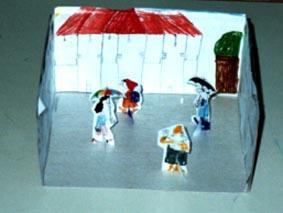Το κουτί της τούρτας μεταμορφώθηκε σε τοπίο βροχής στην πόλη...